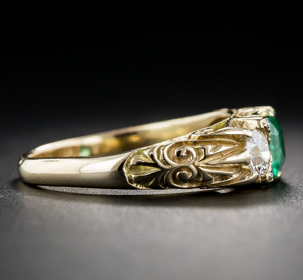 late victorian vintage sculpted emerald trilogy engagement ring