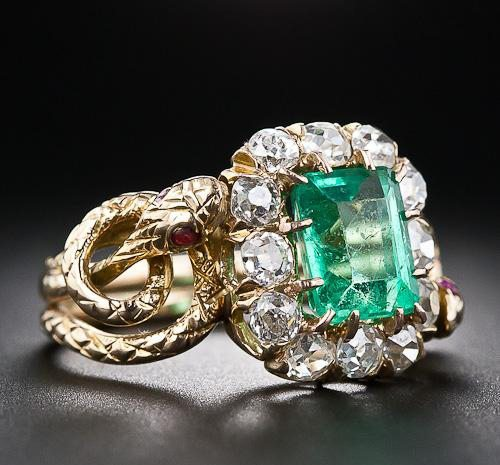 queen Victoria vintage double headed snake ring with emerald