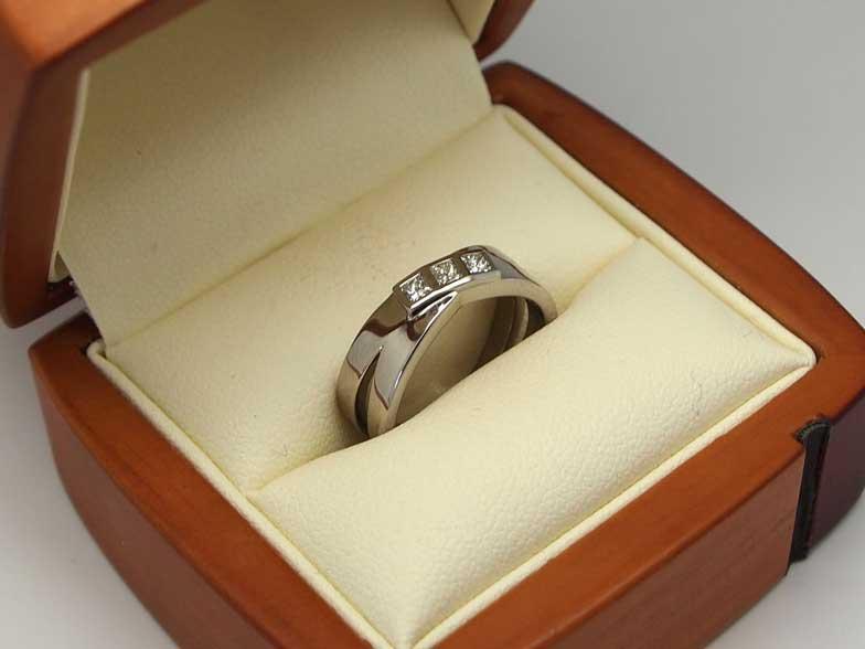 Beautiful palladium bezel set three stone engagement ring
