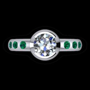 "<a href=""/book-now-bespoke-ring?context=Part bezel set diamond and emerad ring""></a>Part bezel set diamond and emerald ring"