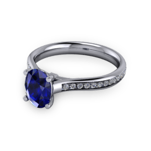 """<a href=""""/book-now-bespoke-ring?context=Oval sapphire commitment ring with accent set shoulders""""></a>Oval sapphire commitment ring with accent set shoulders"""