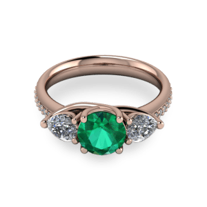 """<a href=""""/book-now-bespoke-ring?context=Rose gold emerald and pear stone ring""""></a>Rose gold emerald and pear stone ring"""