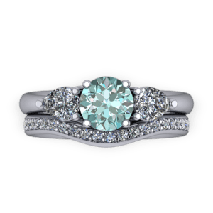 """<a href=""""/book-now-bespoke-ring?context=Blue diamond pear stone ring set""""></a>Blue diamond pear stone ring set"""