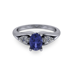 """<a href=""""/book-now-bespoke-ring?context=Oval tanzanite trilogy ring""""></a>Oval tanzanite trilogy ring"""