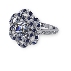 "<a href=""/book-now-bespoke-ring?context=	Diamond and sapphire unique halo vintage engagement ring	"">	</a>	Diamond and sapphire unique halo vintage engagement ring"