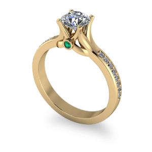"<a href=""/book-now-bespoke-ring?context=	Sculptured yellow gold shank with emerald peak stone	"">	</a>	Sculptured yellow gold shank with emerald peak stone"