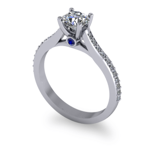 """<a href=""""/book-now-bespoke-ring?context=Four claw round with sapphire peak stone""""></a>Four claw round with sapphire peak stone"""