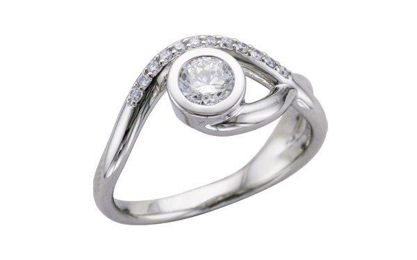 Asymmetric bezel set engagement ring