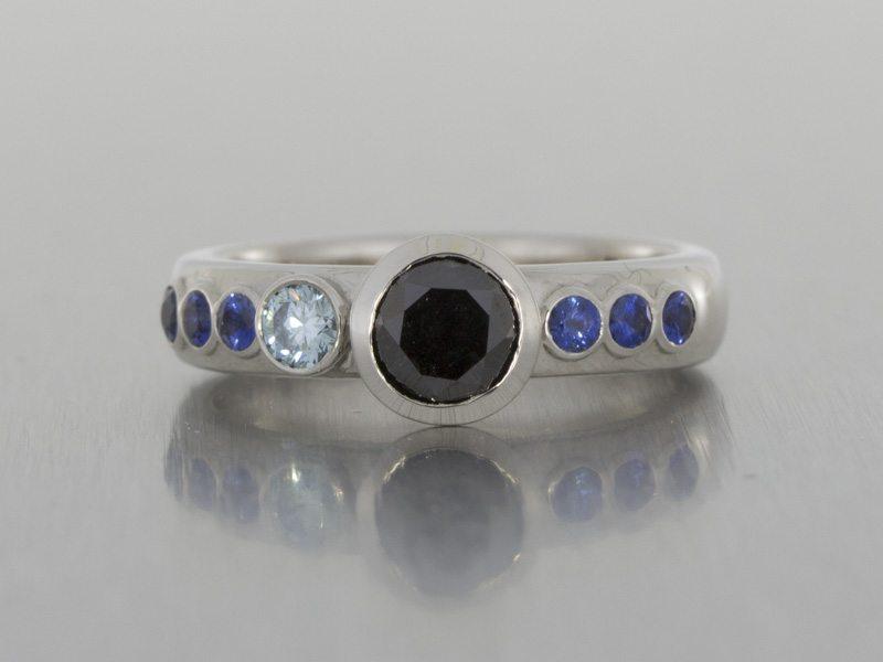 Asymmetrical black and blue diamond engagement ring