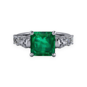 "<a href=""/book-now-bespoke-ring?context=	424-Platinum-emerald-and-diamond-ring-with-skulls	"">	</a>	Platinum emerald and diamond ring with skulls"