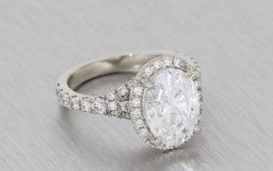 A Striking Oval Diamond Housed In A Stunning Diamond Halo