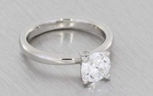 Elegant Platinum Solitaire With Hidden Peak Stone