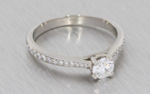 Four-Claw Solitaire Ring with Diamond-Set Shoulders - Portfolio