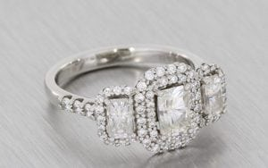 Platinum Three Stone Moissanite And Diamond Halo Ring - Portfolio