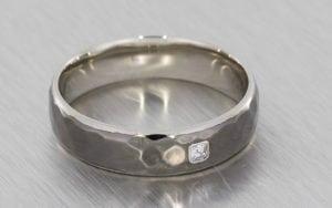 Hammered Men's Contemporary Wedding Band With A Bezel Set Asscher Cut Diamond