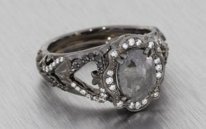 Black rhodium plated gothic style ring with grey white and black diamonds