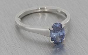 Blue Diamond and Platinum Ring with a Soft Swooping Taper