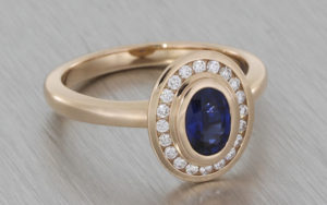 14ct rose gold oval sapphire and diamond ring