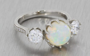 Platinum opal three stone ring with 2 x round brilliant diamonds