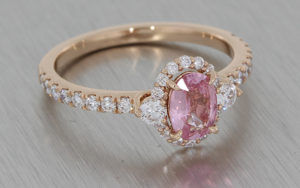 Rose Gold Ring Set with a Pastel Pink Sapphire, Diamond Halo and Shoulders