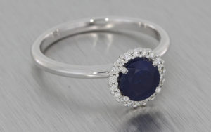 18k White Gold Ring Set with a Beautiful Sapphire Surrounded by a Cluster of Diamonds
